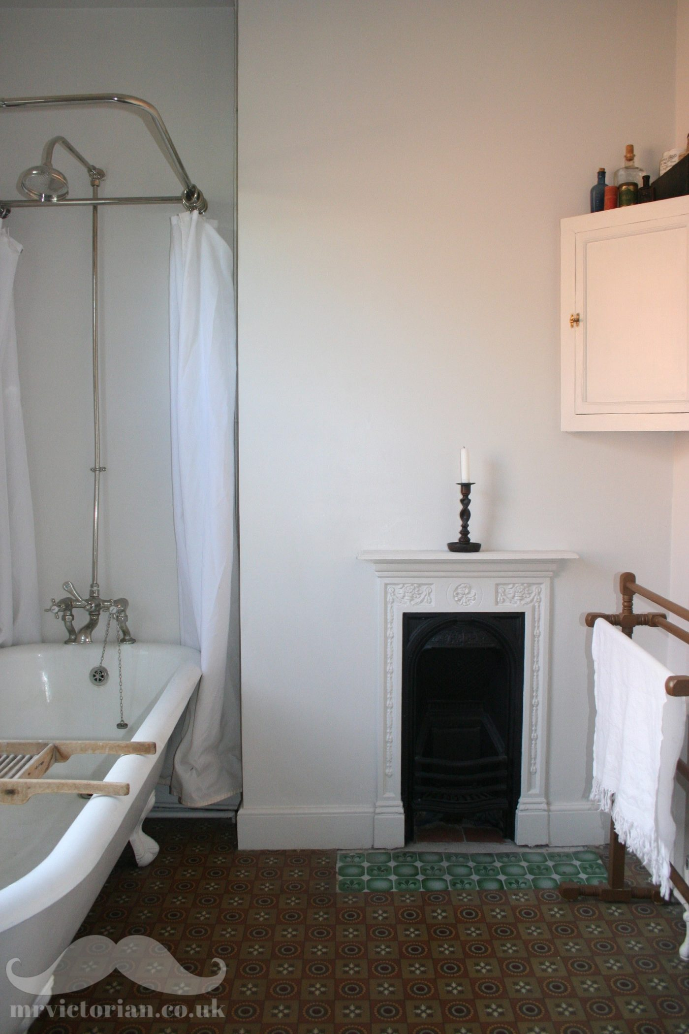 Edwardian bathroom cast iron bath linoleum fireplace