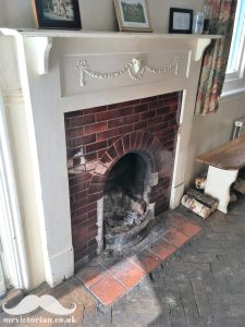 Edwardian tile fireplace with wood surround