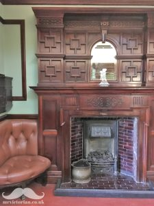 Edwardian tiled fireplace with oak overmantle