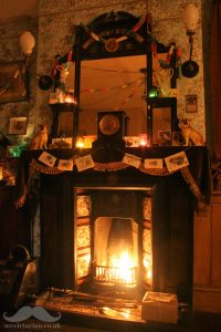 Victorian Christmas fireplace paper chains fairy lights