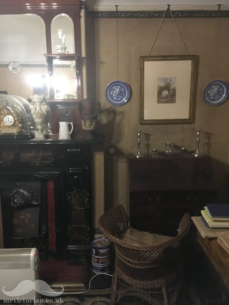 Mr Straw's House parlour featuring Edwardian tiled fireplace